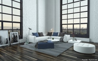 Modern stylish grey and white living room interior with large windows