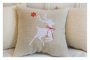 Embroidered reindeer pillow